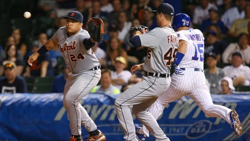 Aug 18, 2015; Chicago, IL, USA; Detroit Tigers first baseman Miguel Cabrera (24) avoids a collision with relief pitcher Buck Farmer (45) to force out Chicago Cubs pinch hitter Chris Denorfia (15) on a double play during the fifth inning at Wrigley Field. Mandatory Credit: Jerry Lai-USA TODAY Sports