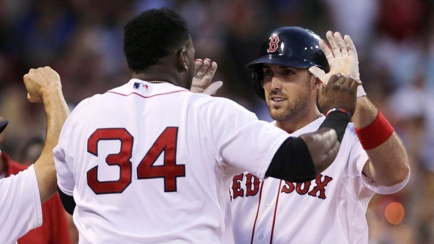 Boston Red Sox's Travis Shaw, right, is congratulated by teammate David Ortiz (34) after their back-to-back home runs off Cleveland Indians starting pitcher Corey Kluber
