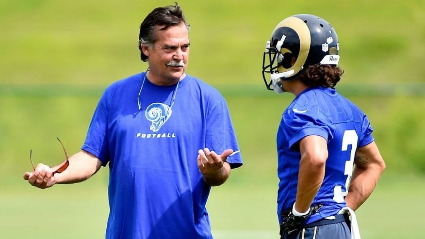 Aug 1, 2015; Earth City, MO, USA; St. Louis Rams head coach Jeff Fisher (L) talks with wide receiver Daniel Rodriguez (3) prior to practice at Rams Park. Mandatory Credit: Jasen Vinlove-USA TODAY Sports