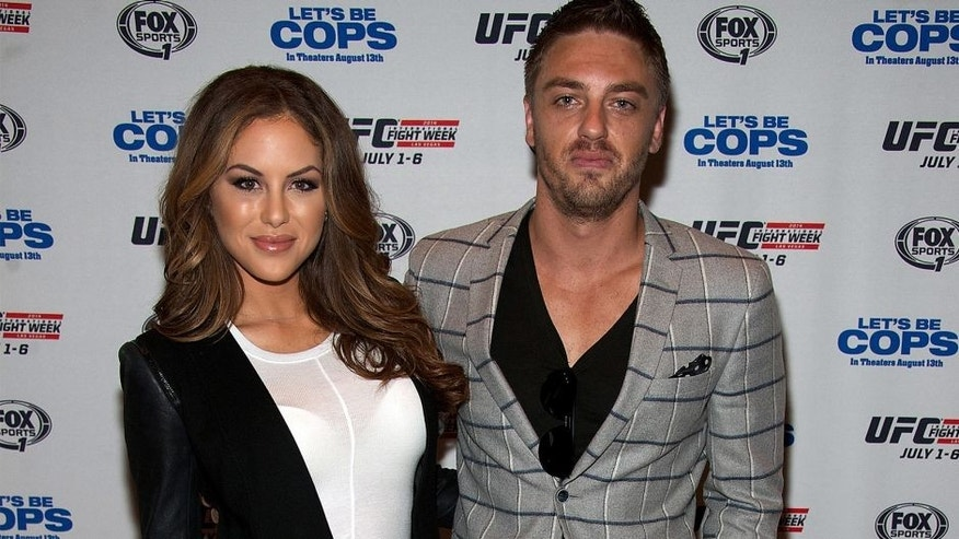 LAS VEGAS, NV - JULY 2: UFC Octagon Girl Brittney Palmer (L) and her husband Aaron Zalewski arrive at the advanced screening of the Twentieth Century Fox film 'Let's Be Cops' during UFC International Fight Week at Brooklyn Bowl Las Vegas at The LINQ on July 2, 2014 in Las Vegas, Nevada. (Photo by Al Powers/Zuffa LLC/Zuffa LLC via Getty Images)