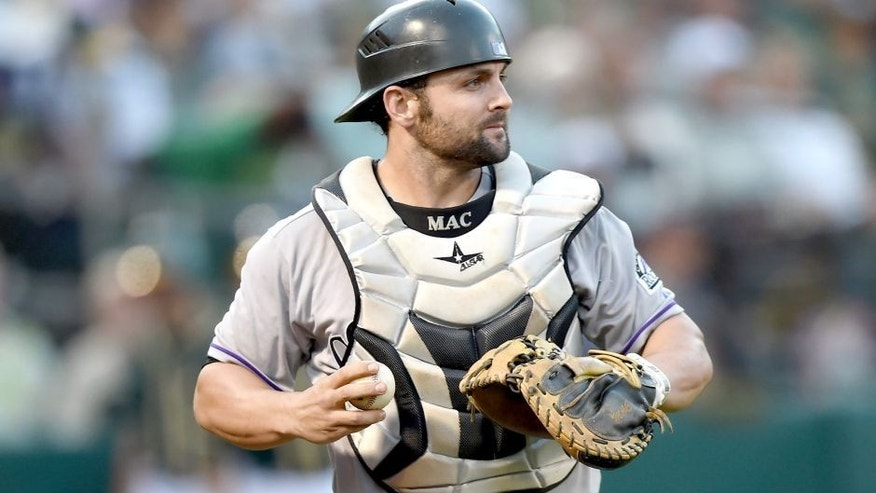 OAKLAND, CA - JUNE 30: Michael McKenry #8 of the Colorado Rockies turns to check the base runner after catching a foul pop-up off the bat of Billy Butler #16 of the Oakland Athletics in the bottom of the fourth inning at O.co Coliseum on June 30, 2015 in Oakland, California. (Photo by Thearon W. Henderson/Getty Images)