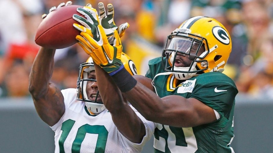<p>Green Bay Packers' Jean Fanor, right, tries to defend a pass intended for Adrian Coxson during the NFL football team's Family Fun Night as part of raining camp, Saturday, Aug. 8, 2015, in Green Bay, Wis. (AP Photo/Mike Roemer),Green Bay Packers' Jean Fanor, right, tries to defend a pass intended for Adrian Coxson during the NFL football team's Family Fun Night as part of raining camp, Saturday, Aug. 8, 2015, in Green Bay, Wis. (AP Photo/Mike Roemer)</p>