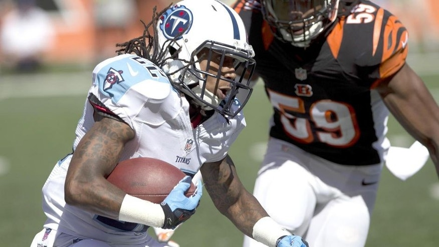 Sep 21, 2014; Cincinnati, OH, USA; Tennessee Titans running back Dexter McCluster (22) carries the ball during the second half against the Cincinnati Bengals at Paul Brown Stadium. The Bengals won 33-7. Mandatory Credit: Aaron Doster-USA TODAY Sports