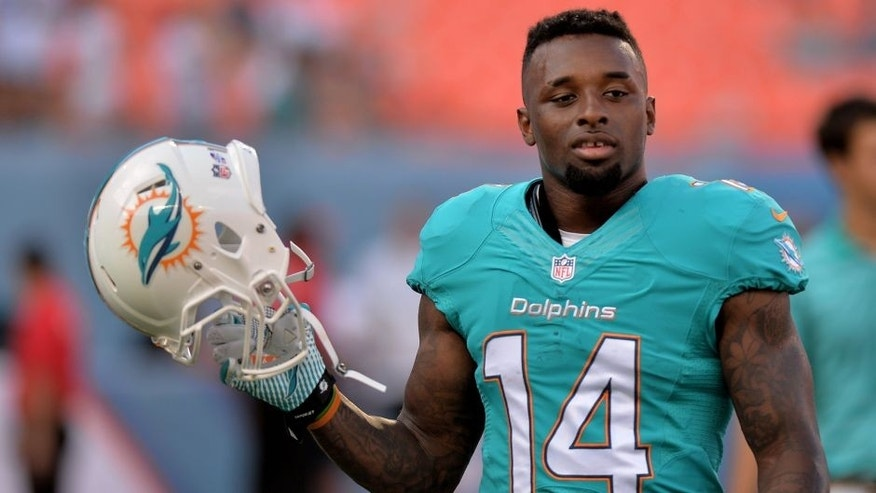 Aug 23, 2014; Miami Gardens, FL, USA; Miami Dolphins wide receiver Jarvis Landry (14) prior to a game against the Dallas Cowboys at Sun Life Stadium. Mandatory Credit: Steve Mitchell-USA TODAY Sports