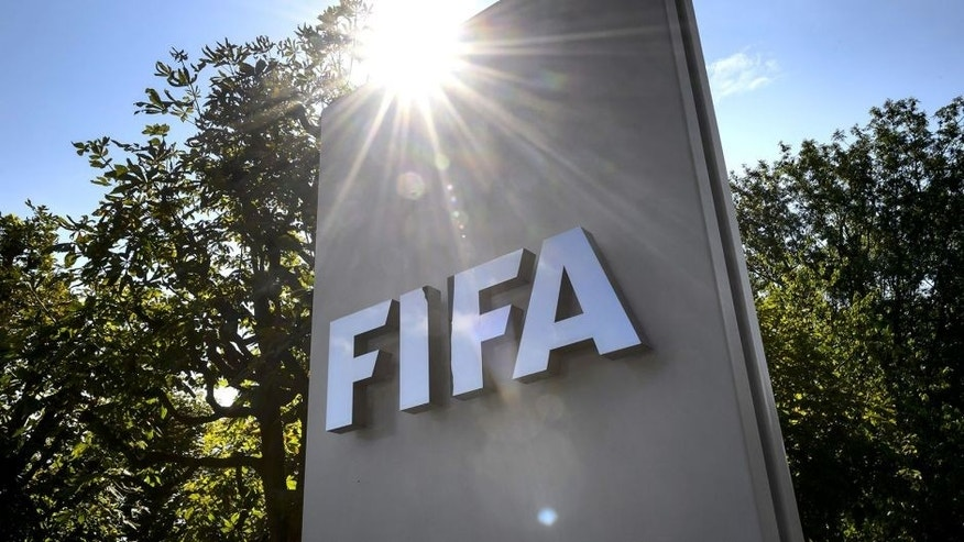 A sign of the FIFA is seen at the entrance of the football's world body on July 20, 2015 in Zurich. FIFA leaders met July 20 to decide a date for an election to replace president Sepp Blatter and reform steps as football's world body confronts its biggest corruption crisis. AFP PHOTO / FABRICE COFFRINI (Photo credit should read FABRICE COFFRINI/AFP/Getty Images)