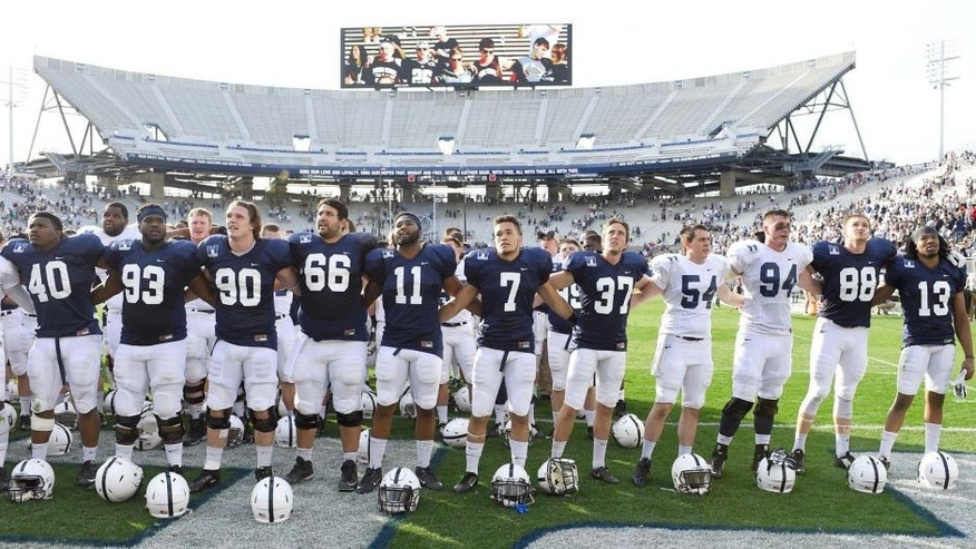 Apr 18, 2015; University Park, PA, USA; Penn State Nittany Lions players sing the alma mater following the Blue White spring game at Beaver Stadium. The Blue team won the game 17-7. Mandatory Credit: Rich Barnes-USA TODAY Sports