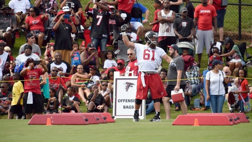 Aug 1, 2015; Atlanta, GA, USA; Atlanta Falcons center Joe Hawley (61) reacts with the fans on the field during training camp at the Flowery Branch Training Facility. Mandatory Credit: Dale Zanine-USA TODAY Sports