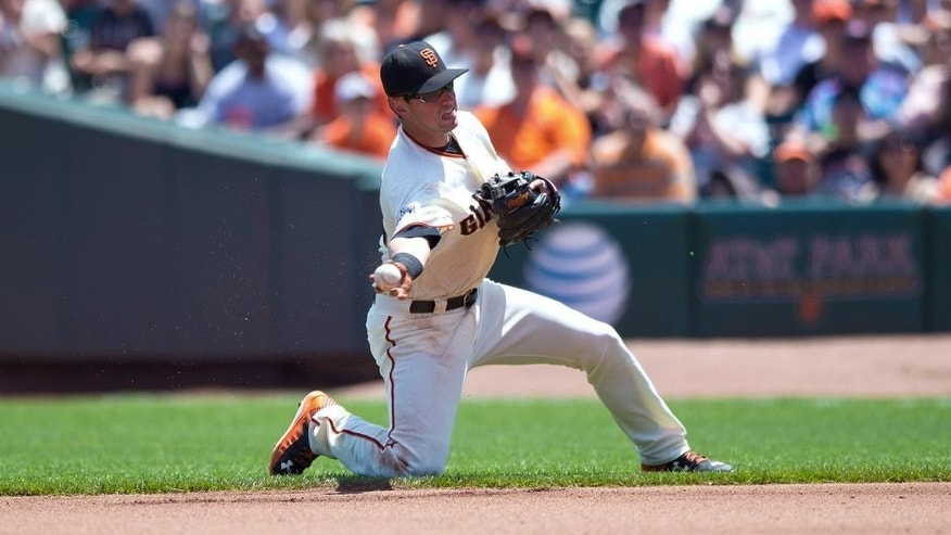 SAN FRANCISCO, CA - JULY 12: Joe Panik #12 of the San Francisco Giants throws to first base after fielding a ground ball against the Philadelphia Phillies during the fourth inning at AT&T Park on July 12, 2015 in San Francisco, California. The San Francisco Giants defeated the Philadelphia Phillies 4-2. (Photo by Jason O. Watson/Getty Images)