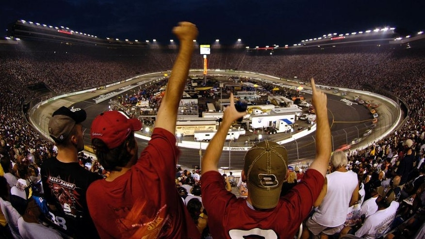 BRISTOL, TN - AUGUST 27: Fans react to a pass by Dale Earnhardt Jr., driver of the #8 Budweiser Chevrolet, during the NASCAR Nextel Cup Series Sharpie 500 on August 27, 2005 at the Bristol Motor Speedway in Bristol, Tennessee. (Photo by Rusty Jarrett/Getty Images)