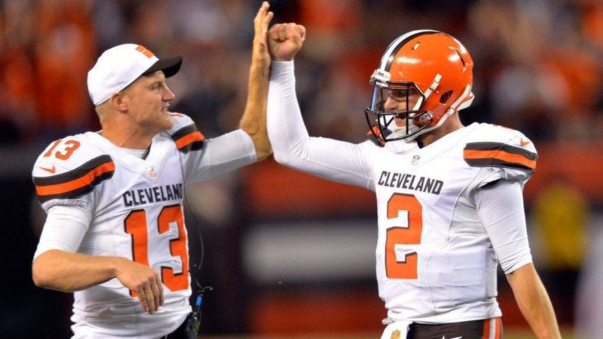 Cleveland Browns quarterback Josh McCown (13) congratulates Johnny Manziel (2) after Manziel threw a 21-yard touchdown pass to Shane Wynn during the fourth quarter of an NFL preseason football game against the Buffalo Bills, Thursday, Aug. 20, 2015, in Cleveland. (AP Photo/David Richard)