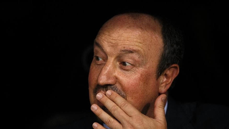 Real Madrid's head coach Rafa Benitez gestures from the bench moments before the Santiago Bernabeu trophy soccer match between Real Madrid and Galatasaray at the Santiago Bernabeu Stadium in Madrid, Tuesday, Aug. 18, 2015. (AP Photo/Daniel Ochoa de Olza)