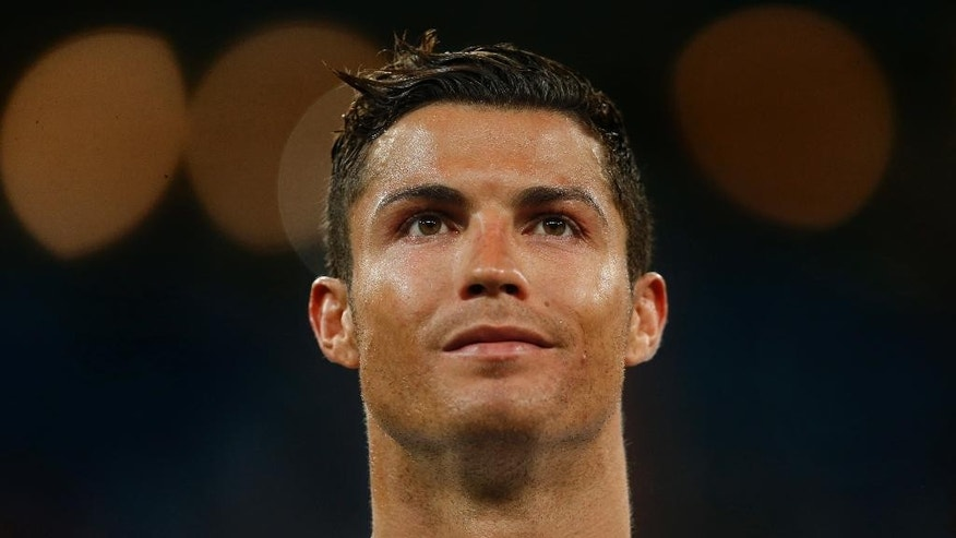 Real Madrid's Cristiano Ronaldo from Portugal, left, reacts after winning the Santiago Bernabeu trophy soccer match between Real Madrid and Galatasaray at the Santiago Bernabeu stadium, in Madrid, Tuesday, Aug. 18, 2015. (AP Photo/Daniel Ochoa de Olza)