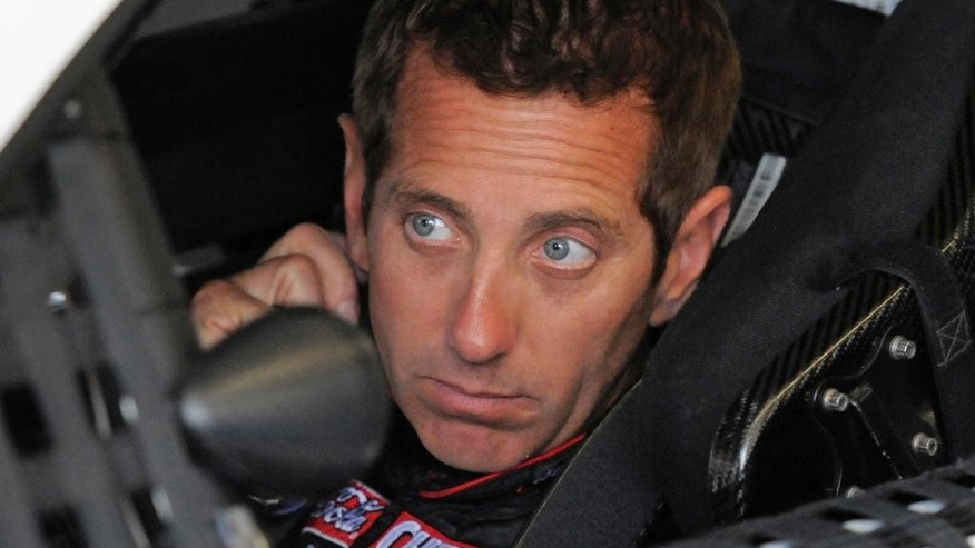 FILE - In this May 21, 2015, file photo, Greg Biffle waits in his car before practice for the NASCAR Coca-Cola 600 Sprint Cup series auto race at Charlotte Motor Speedway in Concord, N.C. Biffle, the most accomplished of Roush Fenway's three drivers with 19 Sprint Cup victories, has not won in 80 races, since June 2013 at Michigan. (AP Photo/Mike McCarn, File)
