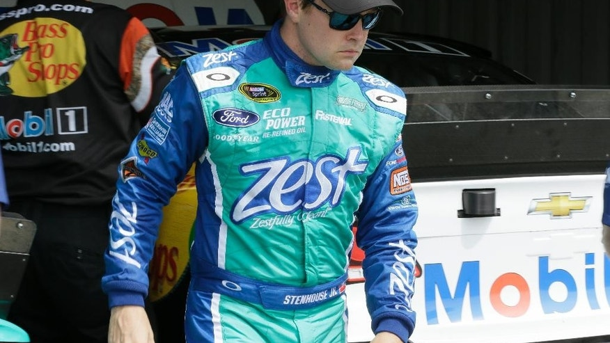 FILE - In this Aug. 14, 2015, file photo, Ricky Stenhouse Jr., leaves the garage after a practice session for the NASCAR Sprint Cup series auto race at Michigan International Speedway in Brooklyn, Mich. Stenhouse's fourth-place finish at Bristol in April is his only top-10 this season. (AP Photo/Carlos Osorio, File)