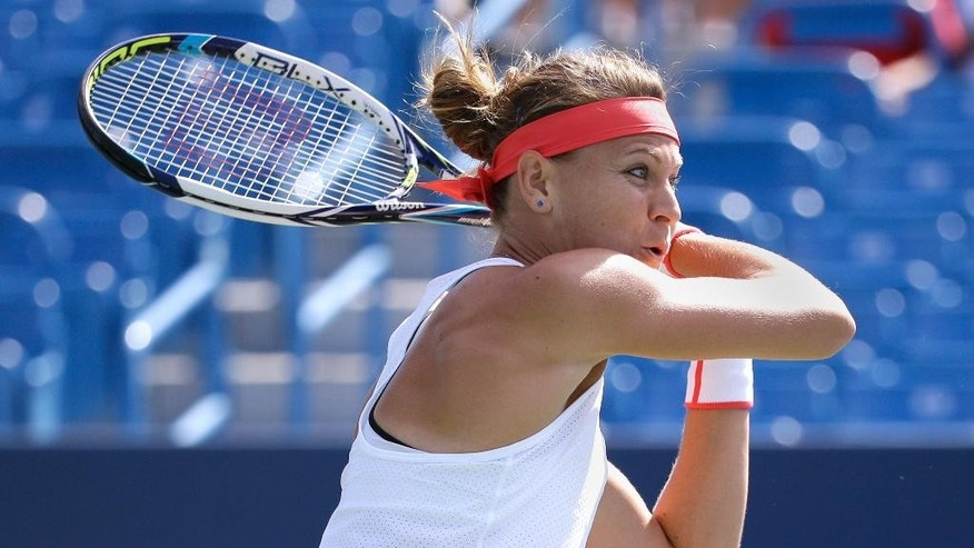 Lucie Safarova, of the Czech Republic, returns the ball to Belinda Bencic, of Switzerland, during a match at the Western & Southern Open tennis tournament, Thursday, Aug. 20, 2015, in Mason, Ohio. (AP Photo/John Minchillo)""