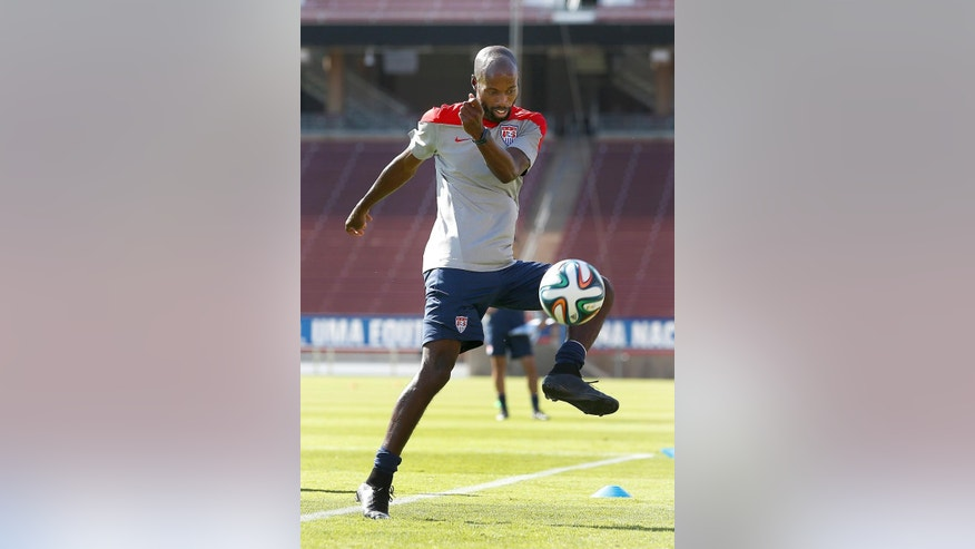FILE - In this May 14, 2014, file photo, United States' DaMarcus Beasley, controls the ball during a training session in Stanford, Calif.  The U.S. Soccer Federation announced Thursday, Aug. 20, 2015, that coach Jurgen Klinsmann had called up goalkeeper Tim  Howard and veteran defender DaMarcus Beasley for exhibitions next month against Peru and Brazil. (AP Photo/Tony Avelar, File)