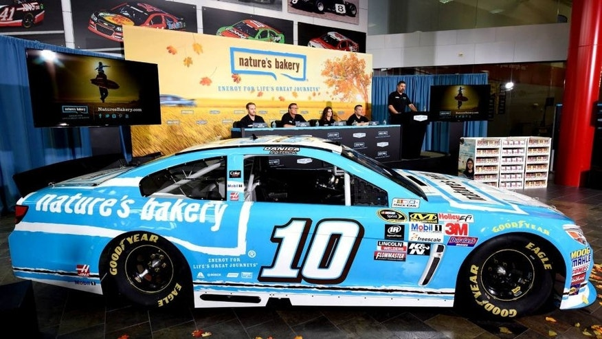 KANNAPOLIS, NC - AUGUST 18: (L-R) Sam and Dave Marson, co-founders of Nature's Bakery, Danica Patrick, driver of the #10 Stewart-Haas Racing Chevrolet, and Tony Stewart, co-owner of Stewart-Haas Racing, announce a multiyear deal partnership as Mike Arning of True Speed Communication looks on during a press conference on August 18, 2015 in Kannapolis, North Carolina. The partnership will begin with the 2016 NASCAR Sprint Cup Series season. (Photo by Jared C. Tilton/Getty Images for Stewart-Haas Racing)