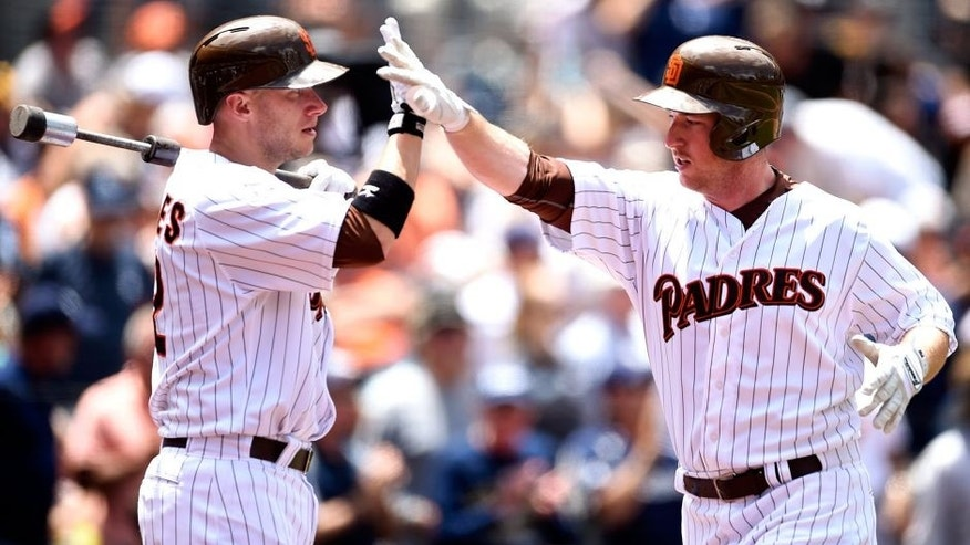 SAN DIEGO, CA - JULY 22: Jedd Gyorko #9 is congratulated by Clint Barmes #12 of the San Diego Padres after hitting a home run during the game against the San Francisco Giants at Petco Park on July 22, 2015 in San Diego, California. (Photo by Andy Hayt/San Diego Padres/Getty Images)