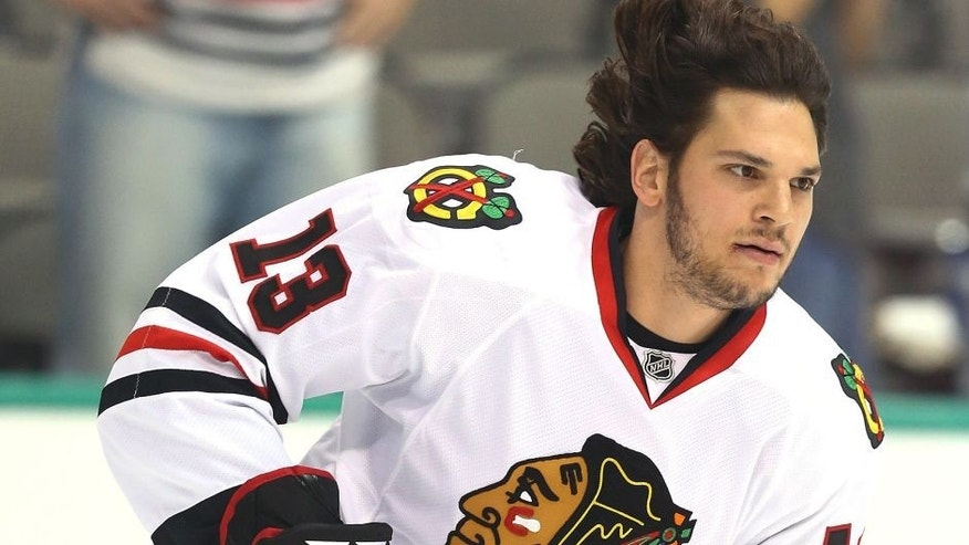 DALLAS, TX - OCTOBER 09: Daniel Carcillo #13 of the Chicago Blackhawks at American Airlines Center on October 9, 2014 in Dallas, Texas. (Photo by Ronald Martinez/Getty Images)