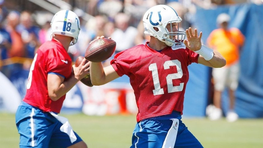 Aug 2, 2015; Anderson, IN, USA; Indianapolis Colts quarterback Andrew Luck (12) throws a pass during training camp at Anderson University. Mandatory Credit: Brian Spurlock-USA TODAY Sports