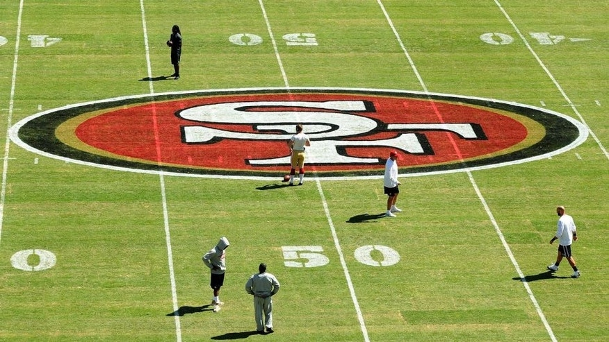 SANTA CLARA, CA - AUGUST Personel stand on the new turf before the San Francisco 49ers play against the San Diego Chargers during a preseason game at Levi's Stadium on August 24, 2014 in Santa Clara, California. (Photo by Noah Graham/Getty Images)