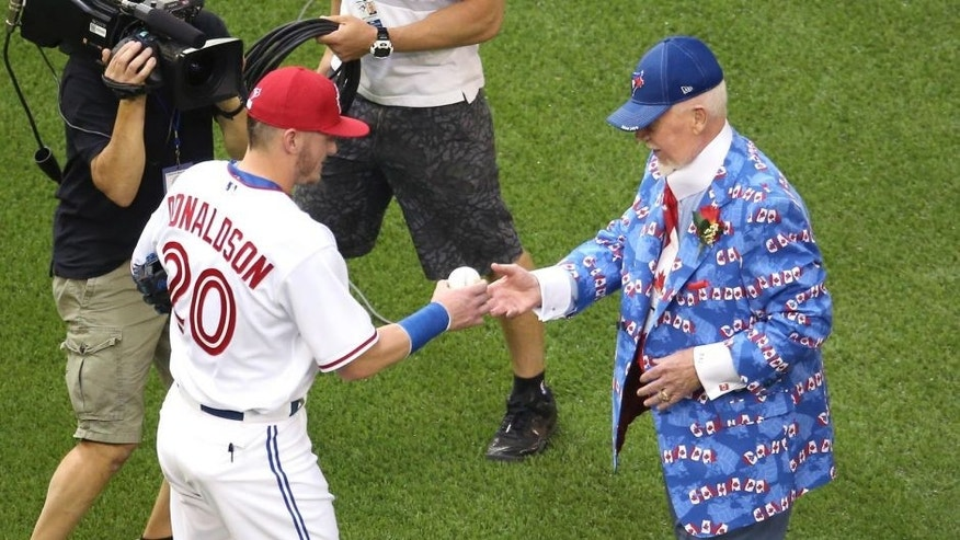 TORONTO, CANADA - JULY 1: Hockey personality Don Cherry is greeted by Josh Donaldson #20 of the Toronto Blue Jays after throwing out the ceremonial first pitch on Canada Day before the start of the game against the Boston Red Sox on July 1, 2015 at Rogers Centre in Toronto, Ontario, Canada. (Photo by Tom Szczerbowski/Getty Images)