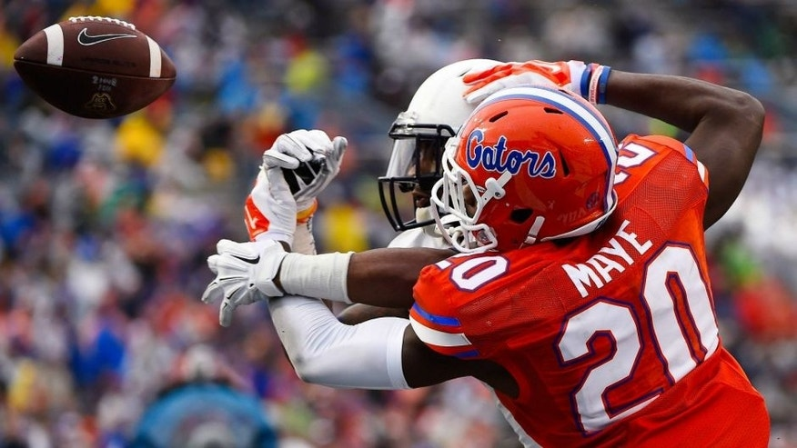 <p>Jan 3, 2015; Birmingham, AL, USA; Florida Gators defensive back Marcus Maye (20) breaks up a pass against East Carolina Pirates wide receiver Justin Hardy (2) during the second quarter of the 2015 Birmingham Bowl at Legion Field. Mandatory Credit: Mike DiNovo-USA TODAY Sports</p>