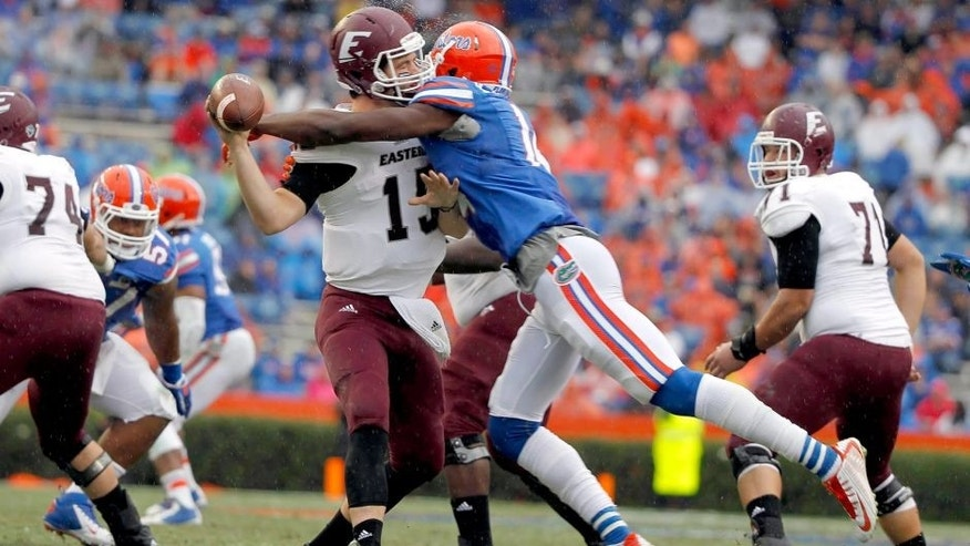 Nov 22, 2014; Gainesville, FL, USA; Florida Gators defensive lineman Alex McCalister (14) sacks Eastern Kentucky Colonels quarterback Barton Mann (15) during the second half at Ben Hill Griffin Stadium. Florida Gators defeated the Eastern Kentucky Colonels 52-3. Mandatory Credit: Kim Klement-USA TODAY Sports