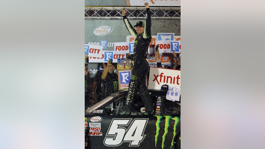Kyle Busch celebrates in Victory Lane after winning the NASCAR Xfinity Series auto race Friday, Aug. 21, 2015, in Bristol, Tenn. (AP Photo/Wade Payne)