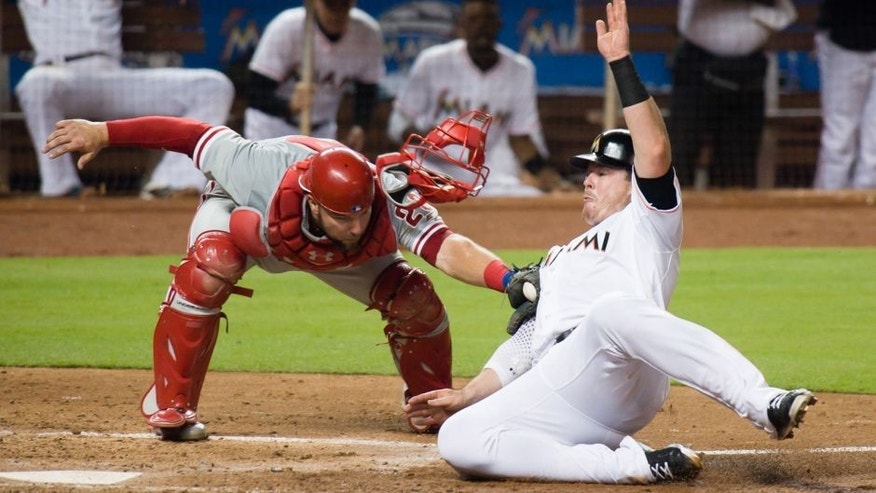 Aug 21, 2015; Miami, FL, USA; Philadelphia Phillies catcher Cameron Rupp (29) tags out Miami Marlins first baseman Justin Bour (48) at home plate during the fourth inning at Marlins Park. Mandatory Credit: Steve Mitchell-USA TODAY Sports