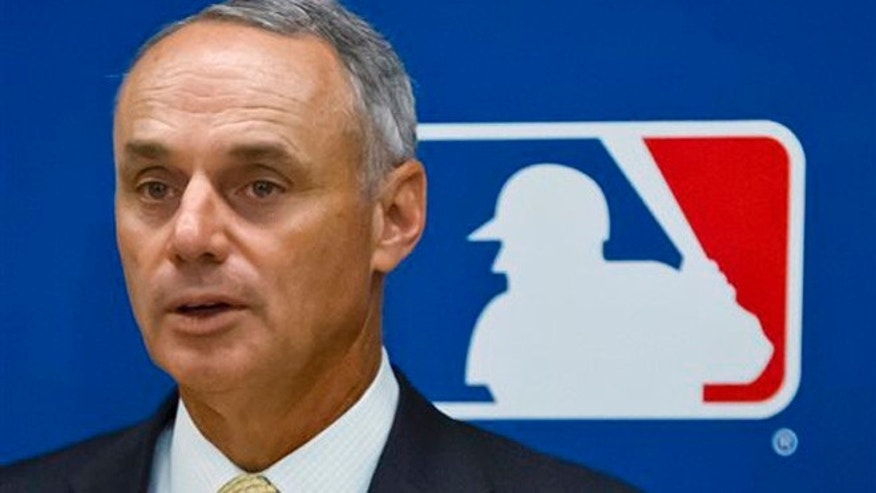May 21, 2015: Baseball Commissioner Rob Manfred speaks during a news conference in New York.