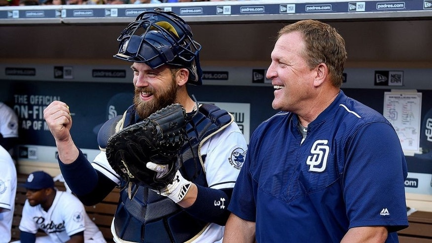 SAN DIEGO, CA - JULY 24: Pat Murphy #24 and Derek Norris #3 of the San Diego Padres talk on the dugout steps prior to the game against the Miami Marlins at Petco Park on July 24, 2015 in San Diego, California. (Photo by Andy Hayt/San Diego Padres/Getty Images)