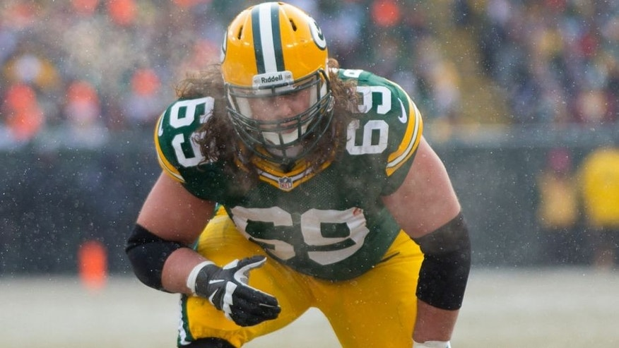 <p>Dec 8, 2013; Green Bay, WI, USA; Green Bay Packers offensive tackle David Bakhtiari (69) during the game against the Atlanta Falcons at Lambeau Field. Green Bay won 22-21. Mandatory Credit: Jeff Hanisch-USA TODAY Sports</p>
