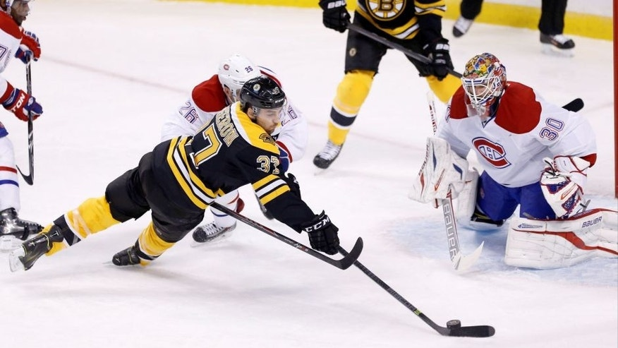 <p>Jan 30, 2014; Boston, MA, USA; Boston Bruins center Patrice Bergeron (37) shoots the puck against Montreal Canadiens goalie Peter Budaj (30) during the first period at TD Banknorth Garden.  </p>