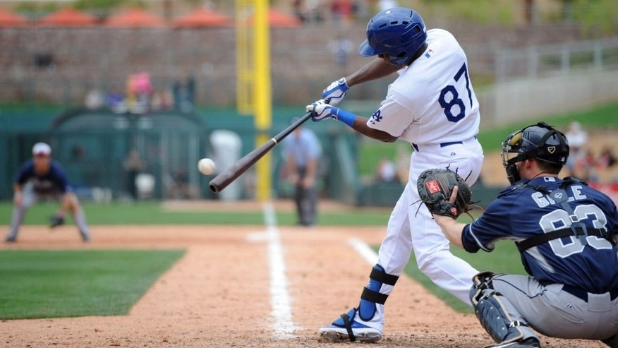 Mar 2, 2014; Phoenix, AZ, USA; Los Angeles Dodgers infielder Darnell Sweeney (87) hits the ball in the ninth inning against the San Diego Padres at Camelback Ranch.The game ended in a 3-3 tie. Mandatory Credit: Joe Camporeale-USA TODAY Sports