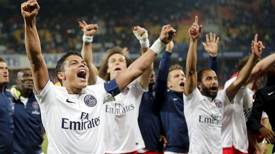 Paris St Germain's players celebrate at the end of their French Ligue 1 soccer match against Montpellier at the Mosson Stadium in Montpellier, France, May 16, 2015. REUTERS/Jean-Paul Pelissier Picture Supplied by Action Images