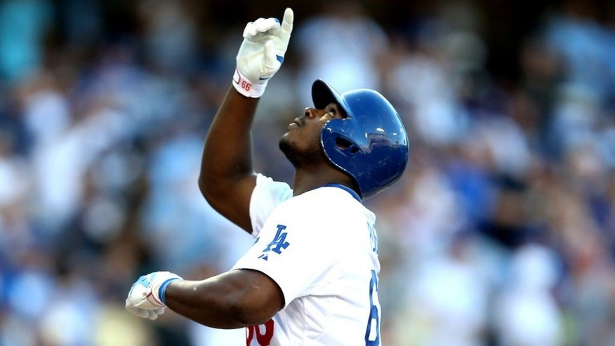 LOS ANGELES, CA - AUGUST 15: Yasiel Puig #66 of the Los Angeles Dodgers celebrates as he crosses home plate after hitting a solo home run in the second inning against the Cincinnati Reds at Dodger Stadium on August 15, 2015 in Los Angeles, California. (Photo by Stephen Dunn/Getty Images)