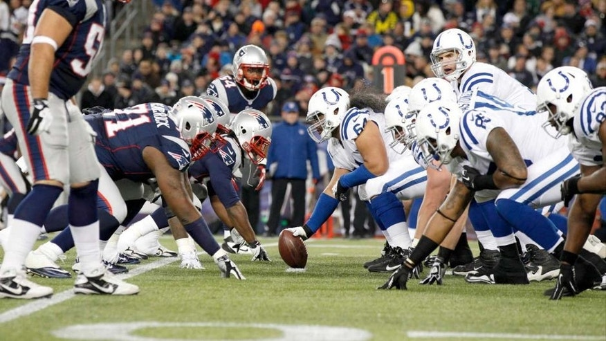 Nov 18, 2012; Foxborough, MA, USA; Indianapolis Colts quarterback Andrew Luck (12) at the line of scrimmage against the New England Patriots during the first half at Gillette Stadium. The Patriots defeated the Indianapolis Colts 59-24. Mandatory Credit: David Butler II-USA TODAY Sports