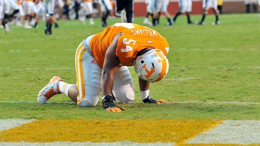 Aug 31, 2014; Knoxville, TN, USA; Tennessee Volunteers defensive lineman Jordan Williams (54) is shaken up on a play against the Utah State Aggies during the first half at Neyland Stadium. Mandatory Credit: Jim Brown-USA TODAY Sports