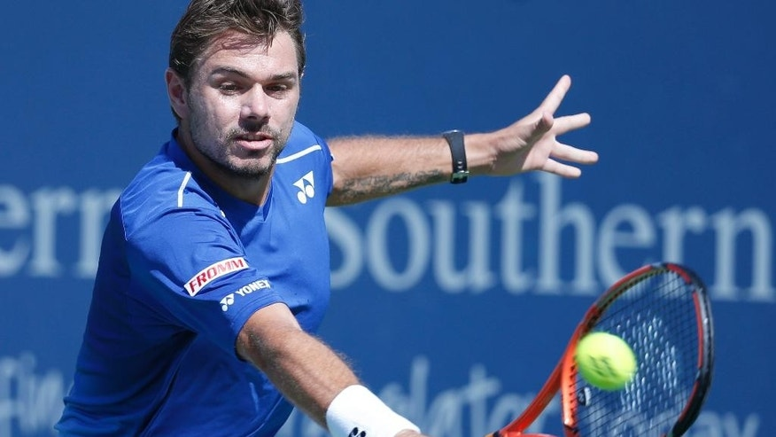 Stanislas Wawrinka, of Switzerland, returns the ball to Novak Djokovic, of Serbia, during a quarterfinal match at the Western & Southern Open tennis tournament, Friday, Aug. 21, 2015, in Mason, Ohio. (AP Photo/John Minchillo)