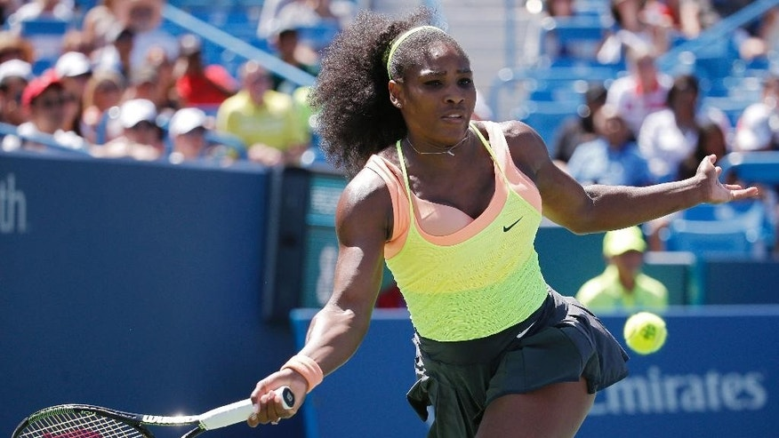Serena Williams returns the ball to Ana Ivanovic, of Serbia, during a quarterfinal match at the Western & Southern Open tennis tournament, Friday, Aug. 21, 2015, in Mason, Ohio. (AP Photo/John Minchillo)
