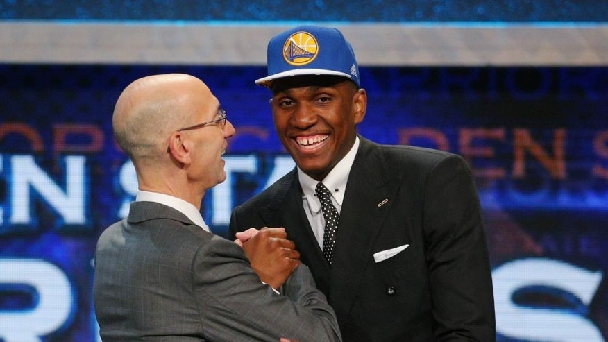 Jun 25, 2015; Brooklyn, NY, USA; Kevon Looney (UCLA) greets NBA commissioner Adam Silver after being selected as the number thirty overall pick to the Golden State Warriors in the first round of the 2015 NBA Draft at Barclays Center. Mandatory Credit: Brad Penner-USA TODAY Sports
