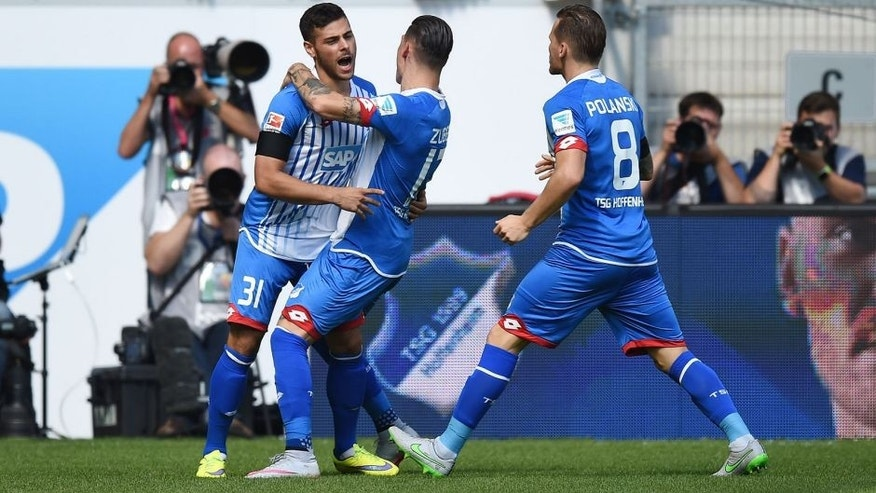 SINSHEIM, GERMANY - AUGUST 22: Kevin Volland of Hoffenheim celebrates with his team-mates after scoring his team's first goal during the Bundesliga match between 1899 Hoffenheim and FC Bayern Muenchen at Wirsol Rhein-Neckar-Arena on August 22, 2015 in Sinsheim, Germany. (Photo by Matthias Hangst/Bongarts/Getty Images)