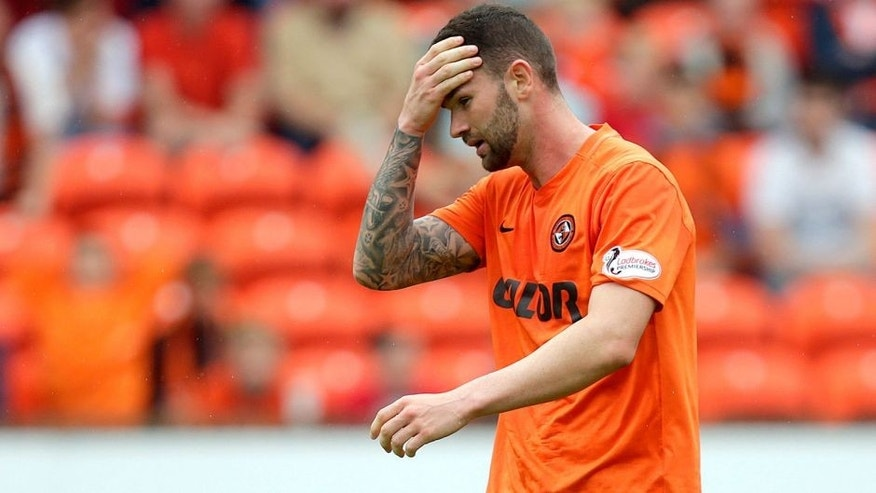 "Football - Dundee United v Celtic - Ladbrokes Scottish Premiership - Tannadice Park - 22/8/15 Dundee United's Mark Durnan looks dejected after scoring an own goal for Celtic Action Images via Reuters / Graham Stuart Livepic EDITORIAL USE ONLY. No use with unauthorized audio, video, data, fixture lists, club/league logos or ""live"" services. Online in-match use limited to 45 images, no video emulation. No use in betting, games or single club/league/player publications. Please contact your account representative for further details."