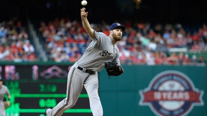 <p>Milwaukee Brewers starting pitcher Taylor Jungmann throws against the Washington Nationals during the first inning of a baseball game at Nationals Park in Washington, Saturday, Aug. 22, 2015. (AP Photo/Jacquelyn Martin)</p>