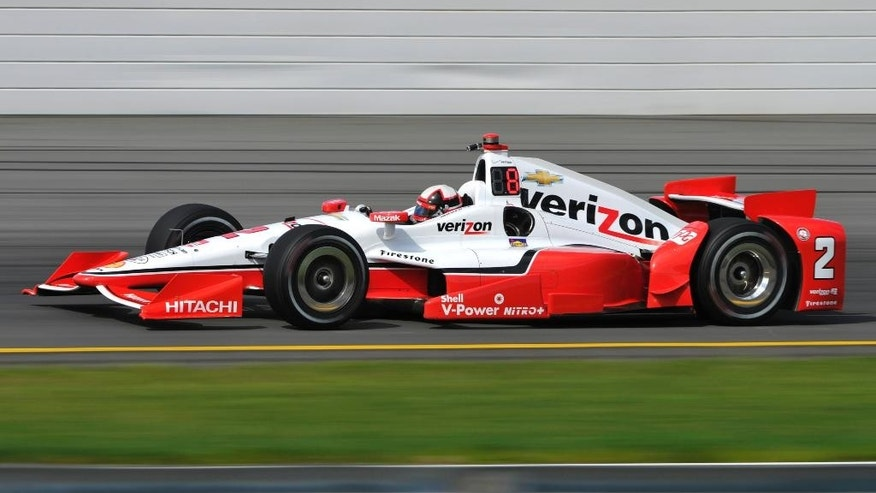 Juan Pablo Montoya, of Colombia, drives through Turn 3 during a practice session for Sunday's Pocono IndyCar 500 auto race , Saturday, Aug. 22, 2015, in Long Pond, Pa. (AP Photo/Derik Hamilton)