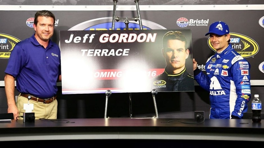 "BRISTOL, TN - AUGUST 21: Jerry Caldwell, General Manager Bristol Motorspeedway, presents Jeff Gordon, driver of the #24 Axalta Chevrolet, with a commemorative section of the grandstand named ""Jeff Gordan Terrace"" during a press conference after practice for the NASCAR Sprint Cup Series Irwin Tools Night Race at Bristol Motor Speedway on August 21, 2015 in Bristol, Tennessee. (Photo by Daniel Shirey/Getty Images)"