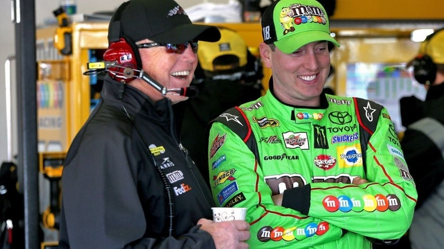 DAYTONA BEACH, FL - FEBRUARY 14: Kyle Busch, driver of the #18 M&M's Crispy Toyota, and team owner Joe Gibbs during practice for the 57th Annual Daytona 500 at Daytona International Speedway on February 14, 2015 in Daytona Beach, Florida. (Photo by Sean Gardner/NASCAR via Getty Images)
