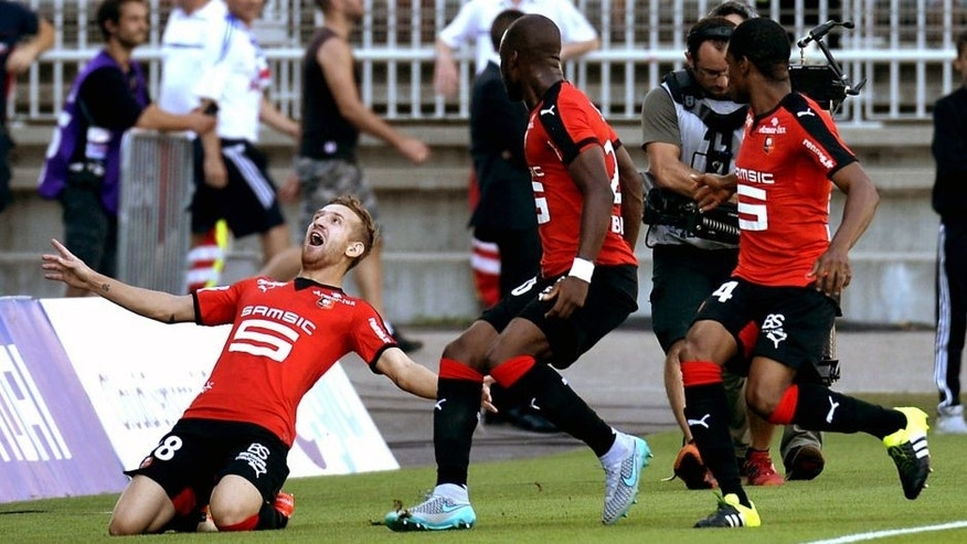 Rennes' forward Pedro Henrique celebrates after scoring a goal during the French L1 football match Lyon (OL) vs Rennes (SRFC) on August 22, 2015, at the Gerland stadium in Lyon, eastern France. AFP PHOTO / JEAN-PHILIPPE KSIAZEK (Photo credit should read JEAN-PHILIPPE KSIAZEK/AFP/Getty Images)