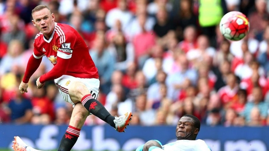 MANCHESTER, ENGLAND - AUGUST 22: Wayne Rooney of Manchester United shoots at goal during the Barclays Premier League match between Manchester United and Newcastle United at Old Trafford on August 22, 2015 in Manchester, England. (Photo by Clive Brunskill/Getty Images)